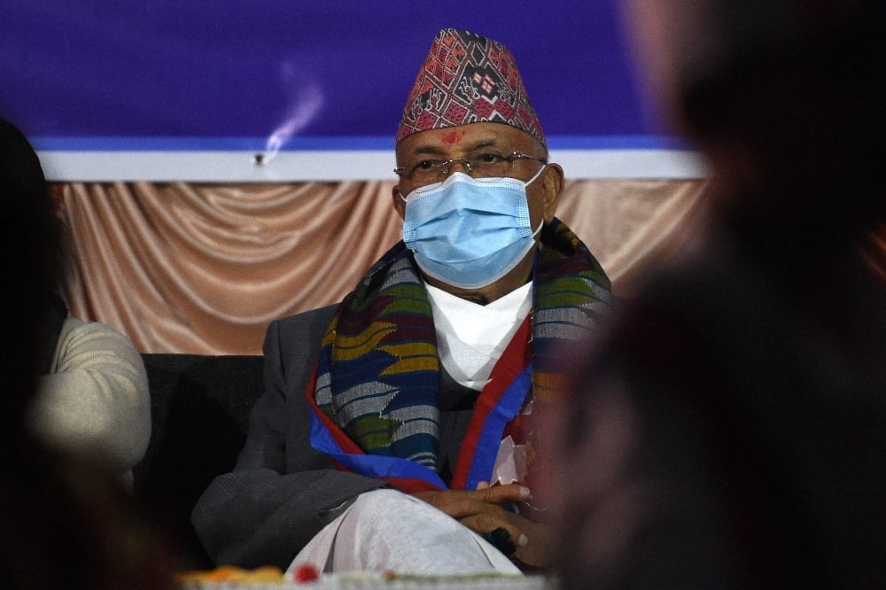 Nepali Prime Minister KP Sharma Oli attends his birthday celebration at an orphanage in Kathmandu on February 23. — AFP