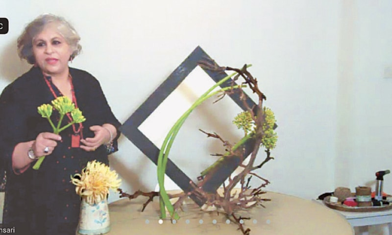 The artist with one of her designs.—White Star