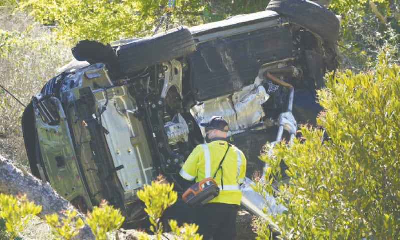 LOS ANGELES: The vehicle of golf star Tiger Woods rests on its side after a rollover accident in Rancho Palos Verdes.—AP