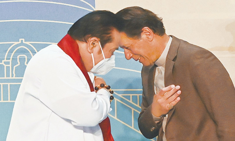 COLOMBO: With their hands on their hearts, Prime Ministers Imran Khan and Mahinda Rajapaksa are all smiles as they opt for a forehead bump amid Covid-19 SOPs during a press conference on Wednesday.—AFP