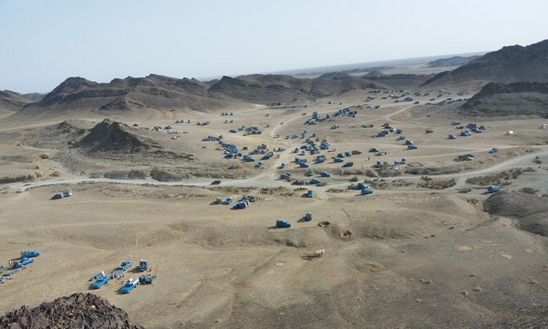 From the top of the Jodar mountains at the Pak-Iran border, pick-up trucks transporting oil look like crawling ants. —Photo courtesy Muhammad Akbar Notezai/File