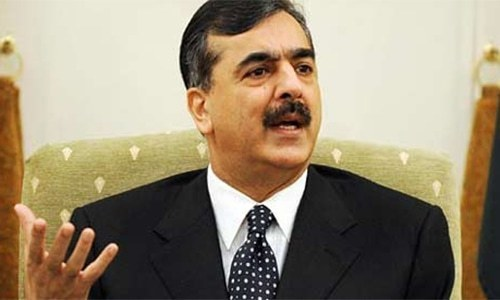 Former premier Yousuf Raza Gilani met PML-N president Shehbaz Sharif at the accountability court here on Wednesday. — AFP/File