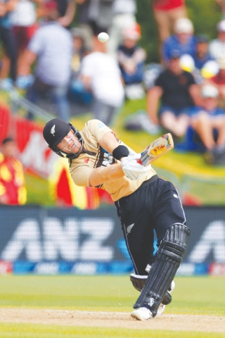NEW ZEALAND opener Martin Guptill hits a six during the second Twenty20 International against Australia at the University Oval on Thursday.—AFP