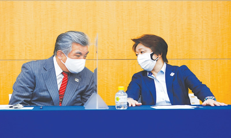 TOKYO: Tokyo Olympics Organising Committee president Seiko Hashimoto (R) speaks to Tokyo 2020 vice-director general Yukihiko Nunomura as they attend the opening remarks session of the press briefing on operation and media coverage of the 2020 Olympics Torch Relay on Thursday.—Reuters