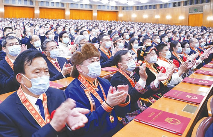 BEIJING: Attendees applaud during the ceremony at the Great Hall of the People on Thursday.—AP