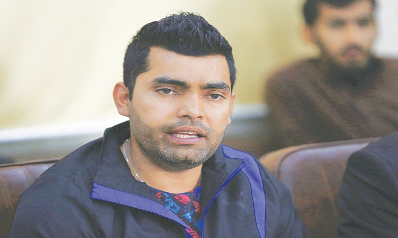 UMAR Akmal gestures during a news conference in Lahore on Friday.—AP