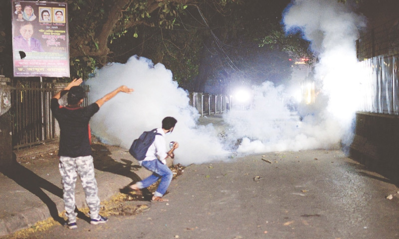 POLICE use tear gas shells on demonstrators protesting the writer's death in prison. — AP