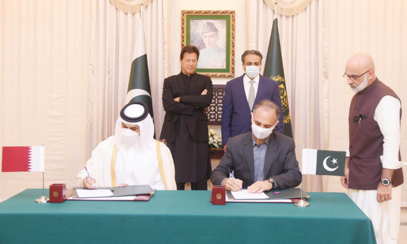 Prime Minister Imran Khan witnesses the signing of the memorandum of understanding (MoU) on LNG between Pakistan and Qatar on Friday. — PID
