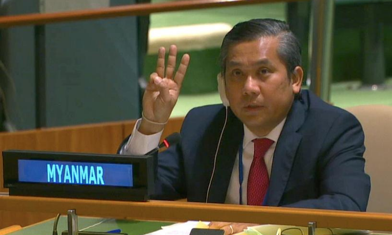Myanmar's ambassador to the United Nations Kyaw Moe Tun holds up three fingers at the end of his speech to the General Assembly where he pleaded for International action in overturning the military coup in his country. — Reuters