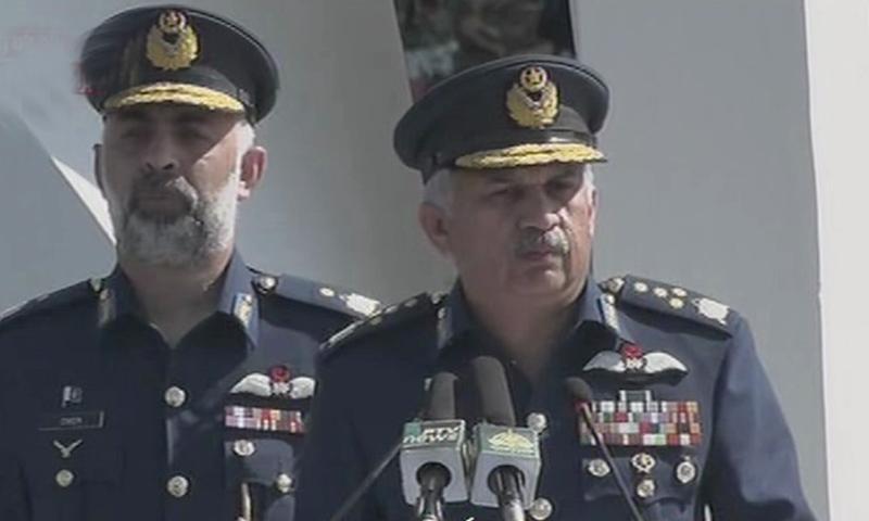 Chief of Air Staff Air Chief Marshal Mujahid Anwar Khan addresses a ceremony at the Air Headquarters in Islamabad on Saturday. — DawnNewsTV