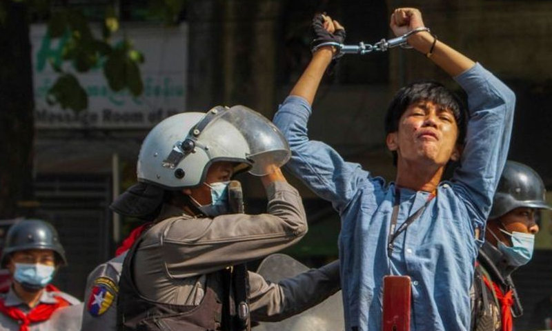 A pro-democracy protester is detained by riot police officers during a rally against the military coup in Yangon, Myanmar, February 27. — Reuters
