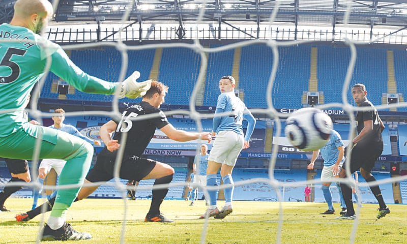 MANCHESTER City's John Stones (second L, obscure) scores against West Ham United during their English Premier League match at the Etihad Stadium on Saturday. — AP