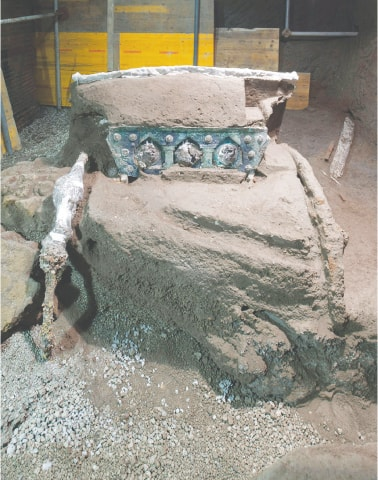 A large Roman four-wheeled ceremonial chariot after it was discovered near the the archaeological park of Pompeii.—AFP
