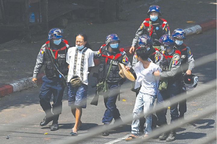 YANGON: Police arresting demonstrators taking part in a protest against the military coup on Saturday. Myanmar authorities have intensified their crackdown on anti-coup protesters.—AFP