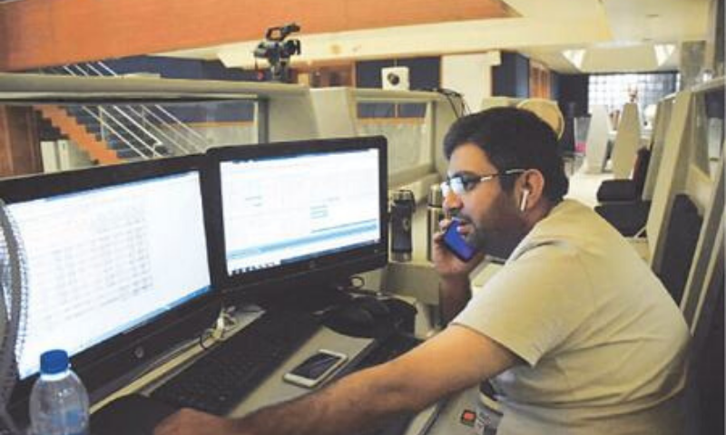 This file photo shows a stock trader at the Pakistan Stock Exchange building in Karachi. — APP