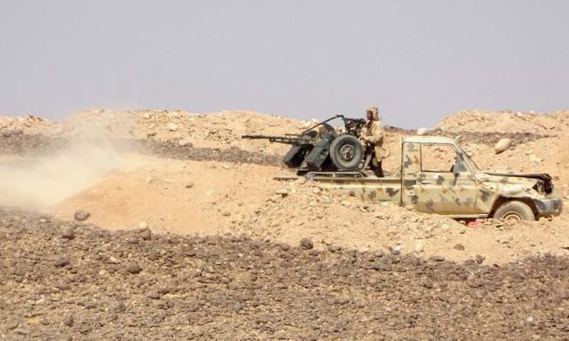 Government forces fire towards Houthi militia fighters during clashes northwest of Marib in central Yemen. — AFP
