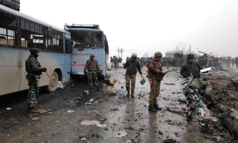 Indian soldiers examine the debris after an explosion in Lethpora in south Kashmir's Pulwama district on February 14, 2019. — Reuters