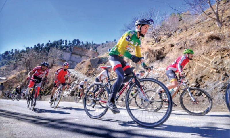 Cyclists on their way to Gabin Jabba top during a race on the concluding day of the sports and cultural festival in Swat.  —  Dawn