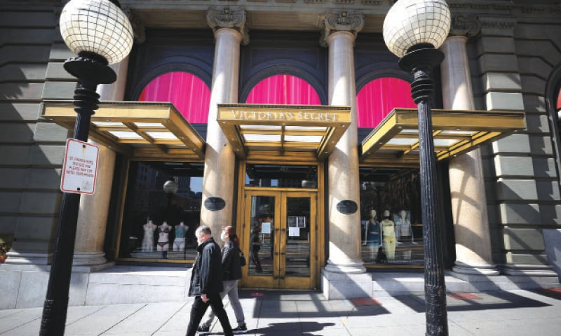 Pedestrians walk by a Victoria's Secret store last week in San Francisco, California.  L Brands, the parent company of Victoria's Secret, announced plans to close 30 to 50 stores in the US and Canada after shuttering over 400 in 2020.—AFP
