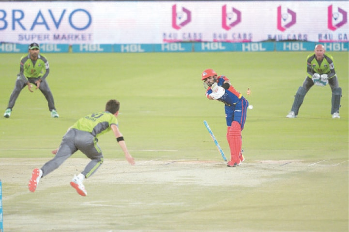KARACHI KINGS opener Babar Azam is cleaned up by Lahore Qalandars paceman Shaheen Shah Afridi on Sunday.—White Star