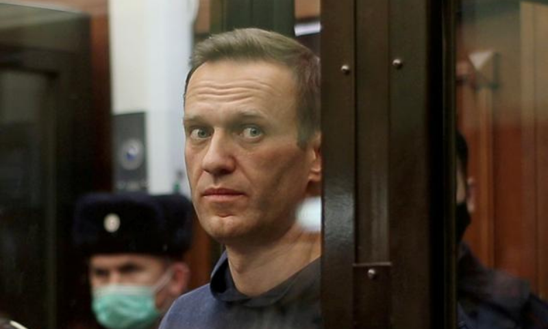 A still image taken from video footage shows Russian opposition leader Alexei Navalny, who is accused of flouting the terms of a suspended sentence for embezzlement, inside a defendant dock during the announcement of a court verdict in Moscow, Russia on February 2. — Reuters/File