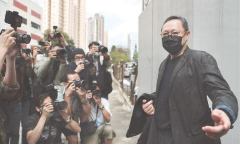 HONG KONG: Former law professor Benny Tai, who was arrested under Hong Kong's national security law, poses for photographers before walking into a police station on Sunday. — AP