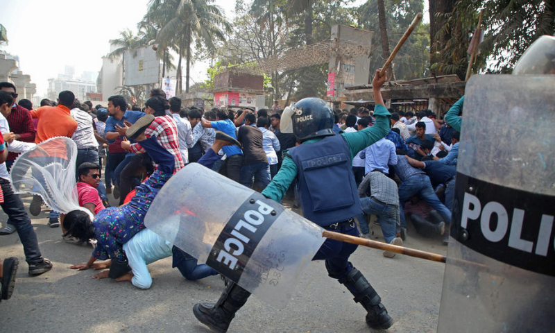 Policemen clash with the activists of Bangladesh Nationalist Party during the third day of protests following the death of Mushtaq Ahmed, a prominent writer and government critic in jail, in front of the National Press Club in Dhaka on Sunday. — AFP