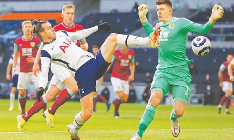 LONDON: Tottenham Hotspur's Gareth Bale vies for the ball with Burnley goalkeeper Nick Pope at the Tottenham Hotspur Stadium.—Reuters