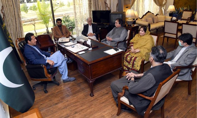 MNAs Khan Mohammad Jamali and Munawara Bibi call on Prime Minister Imran Khan at Islamabad on Monday. — PID