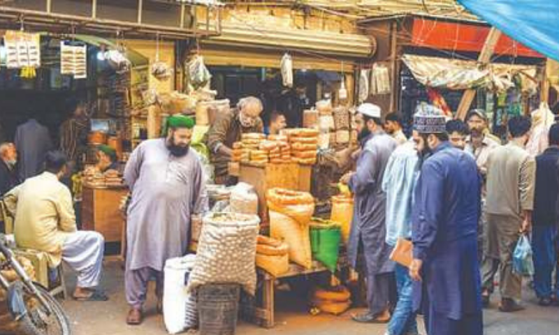 KARACHI: Customers check out dried fruits at a spice store in Jodia Bazaar on Monday. — Fahim Siddiqi / White Star
