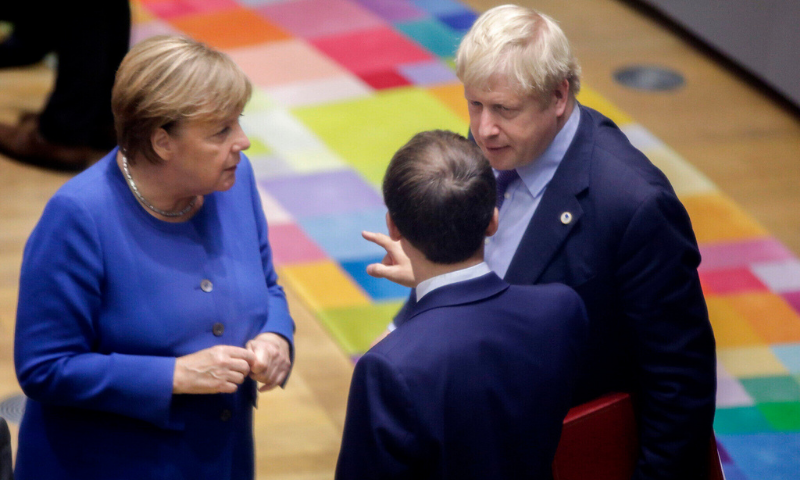 British Prime Minister Boris Johnson, right, speaks with German Chancellor Angela Merkel, left, and French President Emmanuel Macron during a round table meeting at an EU summit in Brussels. — AP/File