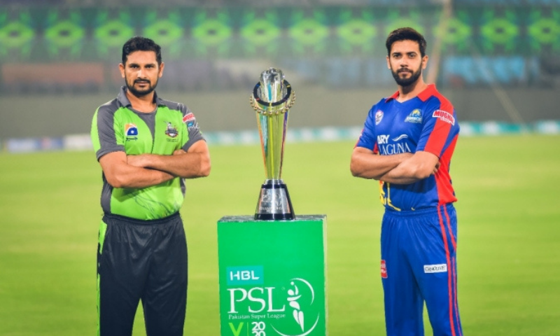 In this file photo, rival skippers Sohail Akhtar of Lahore Qalandars (L) and his Karachi Kings counterpart Imad Wasim pose with the Pakistan Super League trophy on eve of last year's PSL final. — Courtesy PCB