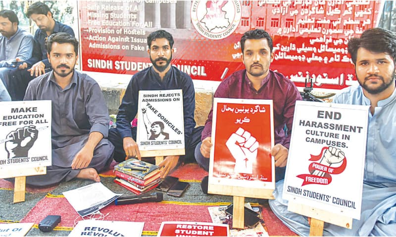 The hunger strikers hold up placards with their demands outside the KPC on Tuesday.—White Star