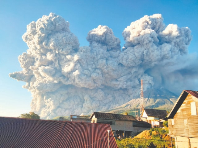 Mount Sinabung spews hot ash some 5,000 metres high into the sky in Indonesia's North Sumatra region on Tuesday.—AFP