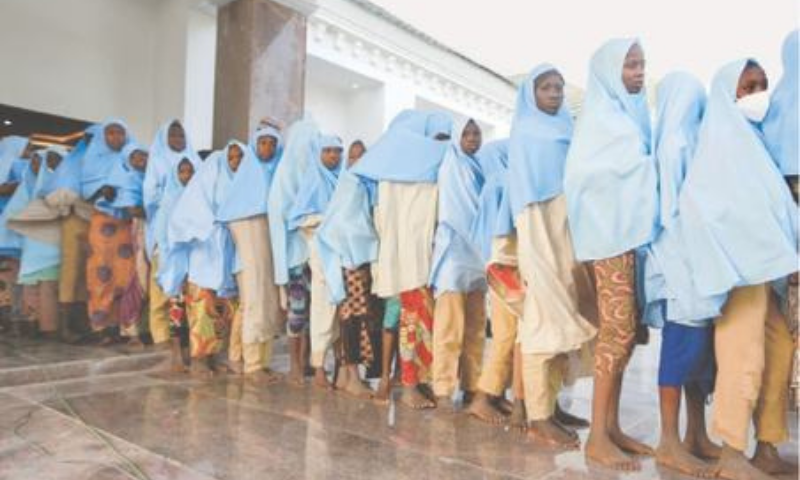 THE kidnapped girls walk in line after their release on Tuesday.—Reuters