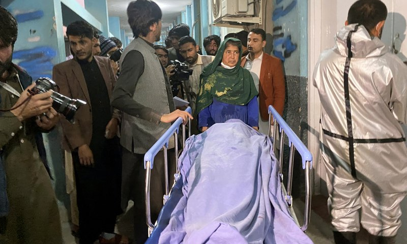 Afghans carry the body of a woman who was killed by gunmen in the city of Jalalabad east of Kabul, Afghanistan on Tuesday, — AP