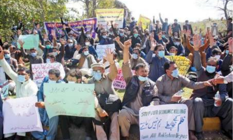 Sacked health workers raise slogans during their protest outside the WHO office in Islamabad on Tuesday. — Online