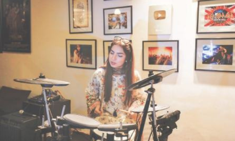 Dananeer Mobeen, 19, a social media influencer, plays drums during her interview. — Reuters