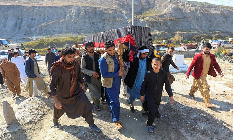 Mourners carry the coffins of three female journalists who were shot dead in Jalalabad on Tuesday. — Reuters