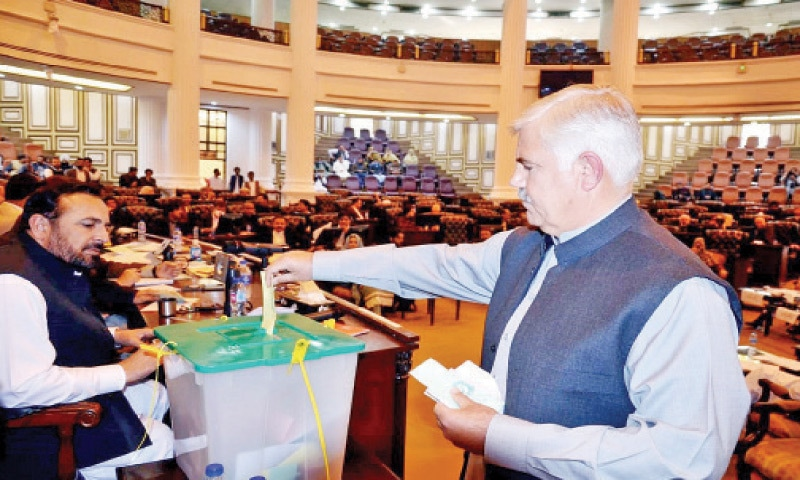 Chief Minister Mahmood Khan casts vote in the Senate elections at the KP Assembly, Peshawar, on Wednesday. (Right) ANP lawmakers make victory signs after their party candidate, Hidayatullah Khan, won a Senate seat.   —  White Star/Dawn
