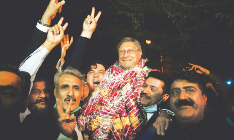The PPP's Farooq Naek is held aloft by jubilant supporters outside the Sindh Assembly building (Shakil Adil/White Star) while MQM-P's newly elected senator Faisal Subzwari speaks to the media on Wednesday evening in this PPI picture.