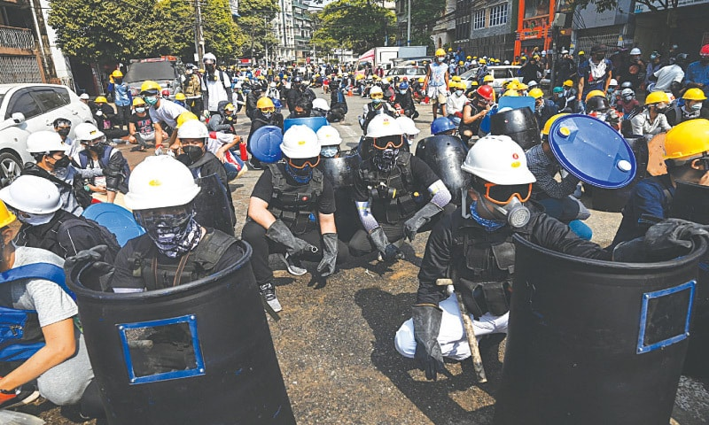 YANGON: Protesters wear protective gear during a demonstration against the military coup on Wednesday. — AFP