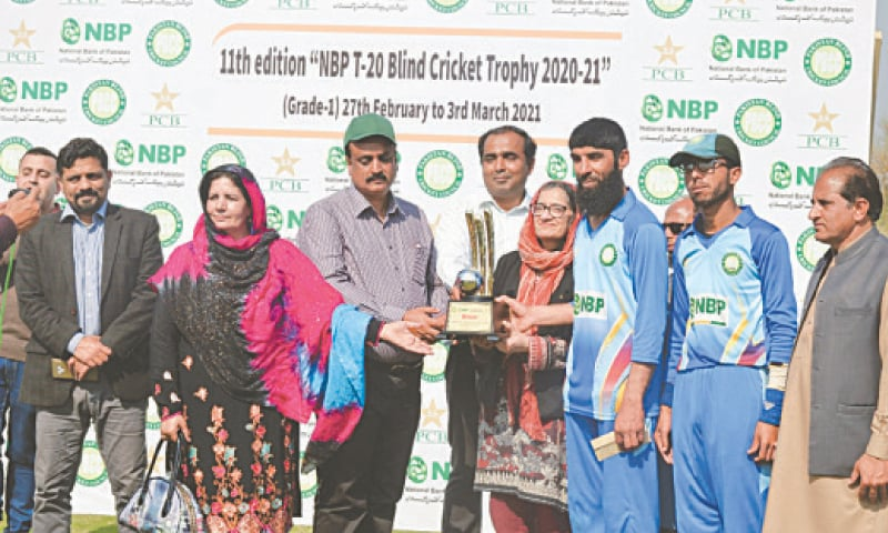 ATTOCK: Chairman PBCC Syed Sultan Shah and Zahida Hamid of NBP jointly present Blind T20 Cricket Trophy to Bahawalpur skipper Zafar Iqbal.