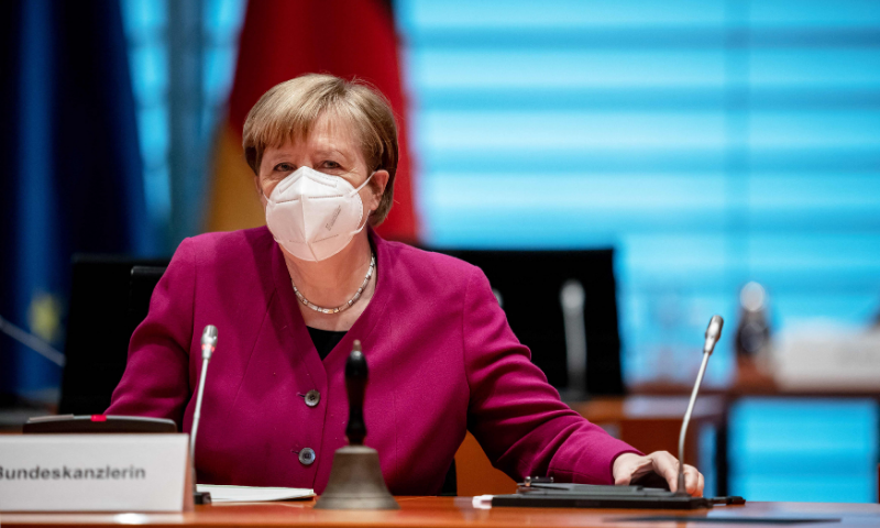 German Chancellor Angela Merkel wears a face mask as she arrives to chair the government's weekly cabinet meeting at the Chancellery in Berlin. — AFP