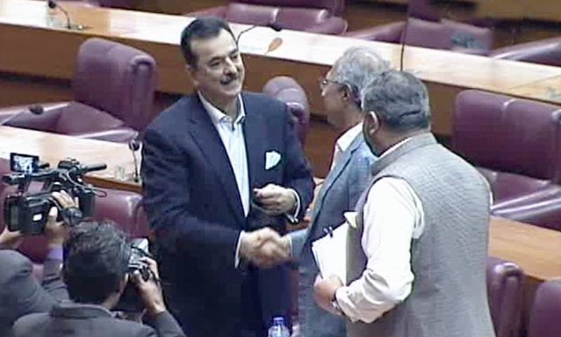 Former prime minister Yusuf Raza Gilani (L) and Finance Minister Hafeez Shaikh (R) meet during the Senate elections on Wednesday. — DawnNewsTV