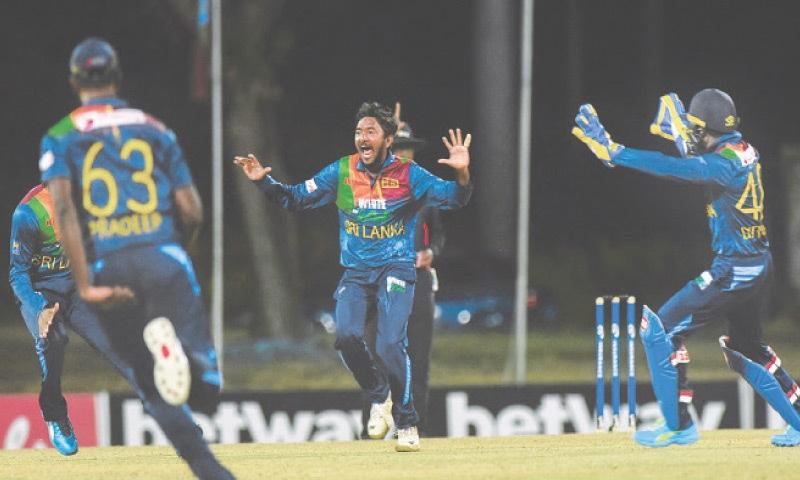 OSBOURN (Antigua and Barbuda): Sri Lankan spinner Akila Dananjaya (C) celebrates the dismissal of West Indies' Nicholas Pooran that gave him a hat-trick during the first T20 International at the Coolidge Cricket Ground.—AFP