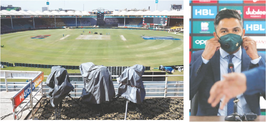 Karachi: A general view of covered television cameras at the National Stadium on Thursday after authorities suspended flagship PSL cricket tournament due to coronavirus cases among teams. Wasim Khan (right), chief executive of the Pakistan Cricket Board, adjusts his mask before addressing a press conference after the suspension of the tournament. — Reuters