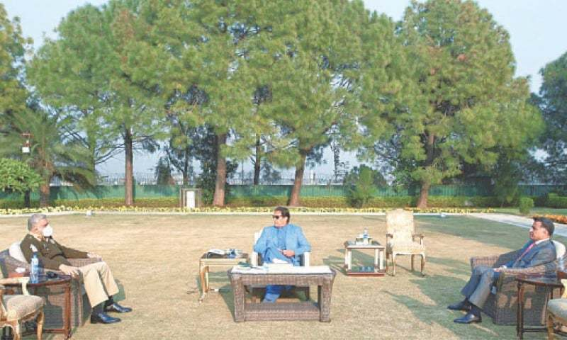 Chief of the Army Staff Gen Qamar Javed Bajwa and ISI DG Lt Gen Faiz Hameed call on Prime Minister Imran Khan at the PM House in this file photo. — White Star