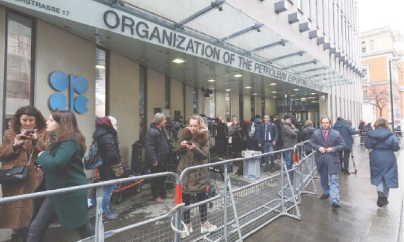 In this March 6, 2020 photo, before the coronavirus pandemic restrictions, people stand outside the headquarters of the Organisation of the Petroleum Exporting Countries in Vienna. — AP