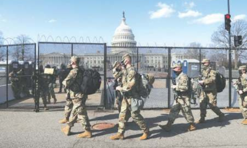 NATIONAL Guard soldiers patrol the grounds of the US Capitol on Thursday. — Reuters